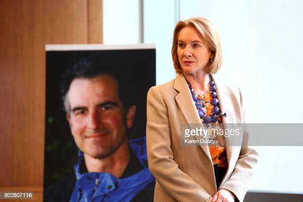 Seattle Mayor Jenny A. Durkan prepares to speak with a reporter with a photo of federal prosecutor Tom Wales behind her after a press conference on...