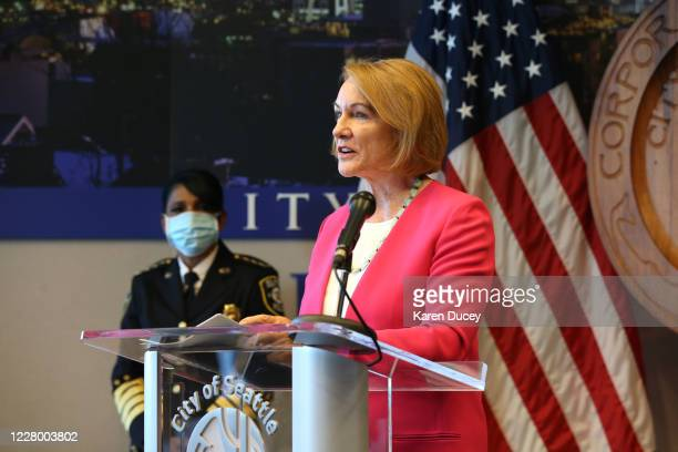 Seattle Mayor Jenny Durkan speaks at a press conference while Seattle Police Chief Carmen Best looks on after she announced her resignation at...