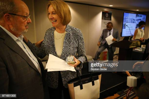 Seattle Mayor Jenny Durkan talks with Beaverton, OR Mayor Denny Doyle, left, before a panel discussion on housing during the 2018 United States...