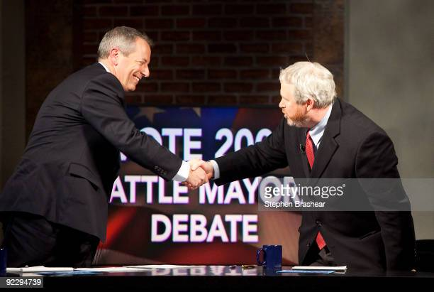 Seattle mayoral candidates Joe Mallahan and Mike McGinn shake hands after debating in a KCTS 9 television studio on October 22 2009 in Seattle...