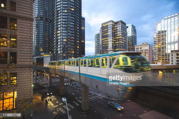 seattle monorail entering westlake center, downtown at sunset - monorail stock pictures, royalty-free photos & images