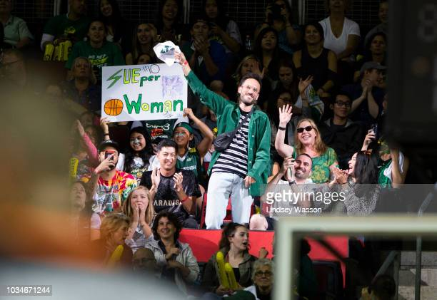 Seattle musician Sol waves to the crowd during the first half of Game 2 of the WNBA Finals at KeyArena on September 9 2018 in Seattle Washington The...