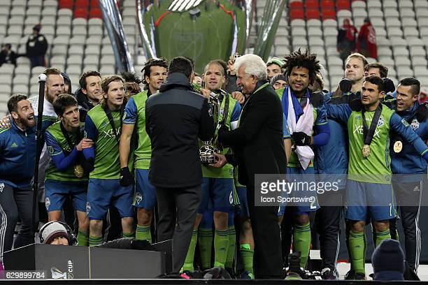 Seattle owners Adrian Hanauer and Joe Roth hand the Philip F Anschutz Trophy to team captain Osvaldo Alonso Toronto FC hosted Seattle Sounders FC in...