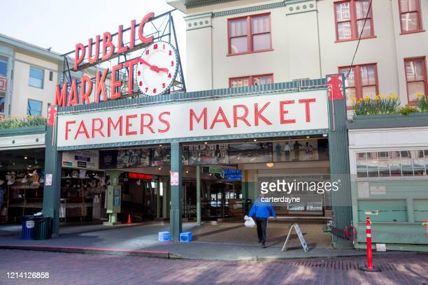 seattle pike place market and the coronavirus covid-19 pandemic - human settlement stock pictures, royalty-free photos & images