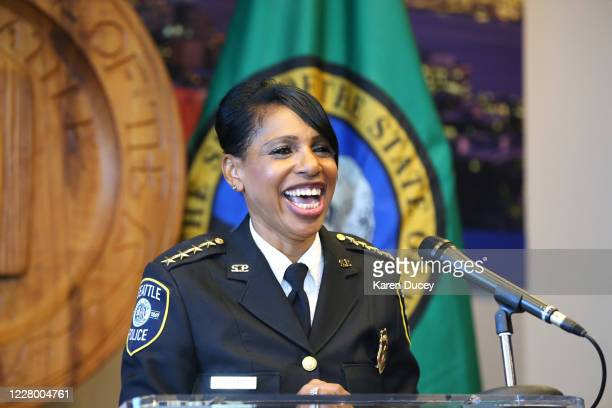 Seattle Police Chief Carmen Best smiles wide as she announces her resignation at a press conference at Seattle City Hall on August 11, 2020 in...