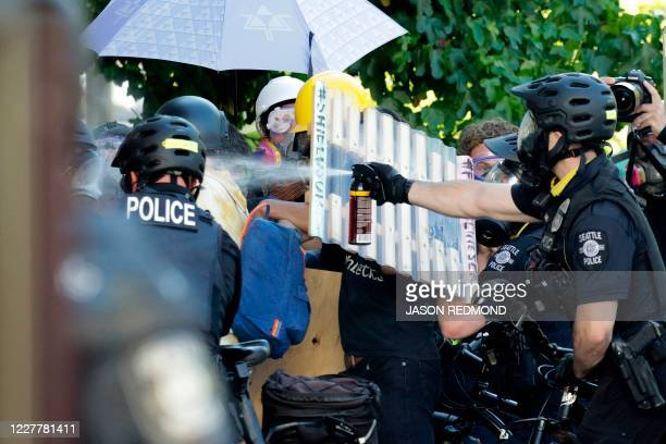 """Seattle police pepper spray protesters following a """"Youth Day of Action and Solidarity with Portland"""" demonstration in Seattle, Washington on July..."""