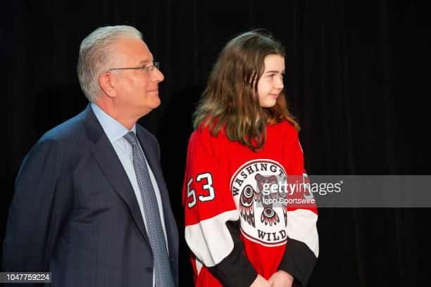 Seattle President CEO Tod Leiweke and honorary guest Washington Wild player Jaina Goscinski listen during a press conference to announce the...