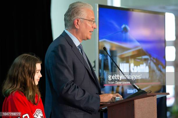 Seattle President CEO Tod Leiweke answers questions with special guest Washington Wild player Jaina Goscinski at his side during a press conference...