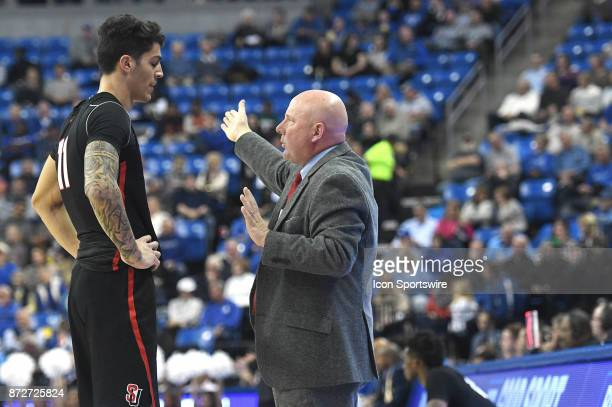 Seattle Redhawks basketball coach Jim Hayford talks to Seattle Redhawks forward Scott Ulaneo during a nonconference men's basketball game between the...
