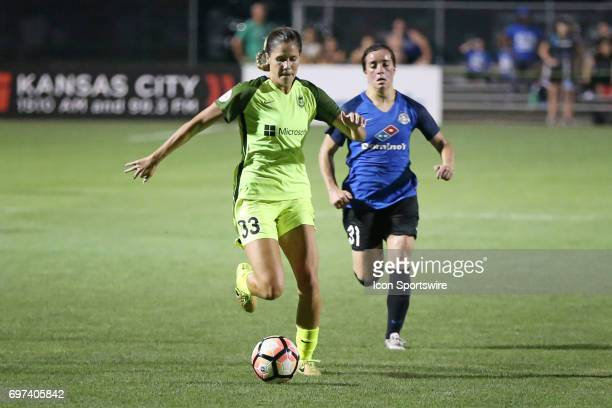 Seattle Reign FC forward Katlyn Johnson races to the goal ahead of FC Kansas City defender Christina Gibbons in the second half of an NWSL match...
