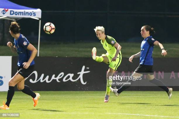 Seattle Reign FC forward Megan Rapinoe centers a ball in the second half of an NWSL match between the Seattle Reign FC and FC Kansas City on June 17...