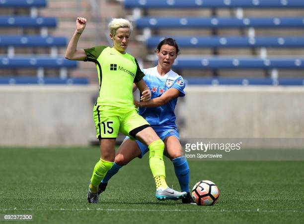 Seattle Reign FC forward Megan Rapinoe is defended by Chicago Red Stars midfielder Vanessa DiBernardo during a game between the Seattle Reign FC and...