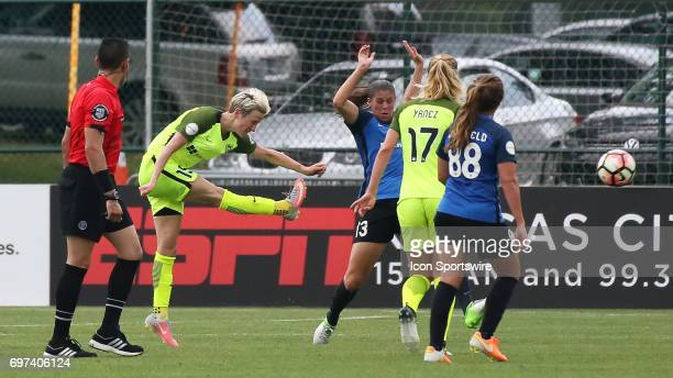Seattle Reign FC forward Megan Rapinoe sends a shot past FC Kansas City defender Brittany Taylor in the first half of an NWSL match between the...