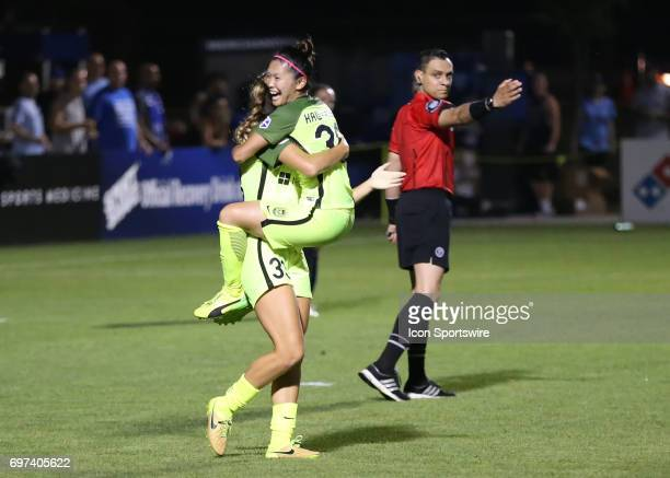 Seattle Reign FC forward Nahomi Kawasumi celebrates her second half goal with forward Katlyn Johnson in an NWSL match between the Seattle Reign FC...