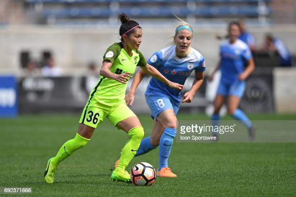 Seattle Reign FC forward Nahomi Kawasumi controls the ball next to Chicago Red Stars midfielder Julie Ertz in the second half during a game between...