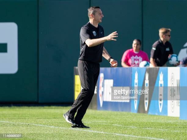 Seattle Reign FC head coach Vlatko Andonovski reacts to a call during the NWSL soccer match between the North Carolina Courage and the Seattle Reign...