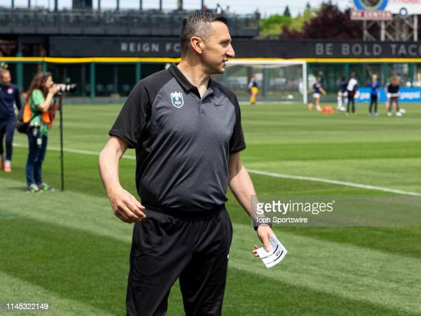 Seattle Reign FC head coach Vlatko Andonovski takes the field before the NWSL soccer match between the Sky Blue FC and the Seattle Reign on May 18...
