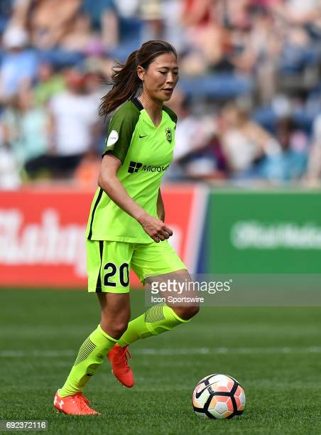 Seattle Reign FC midfielder Rumi Utsugi dribbles with the ball during a game between the Seattle Reign FC and the Chicago Red Stars on June 4 2017 at...
