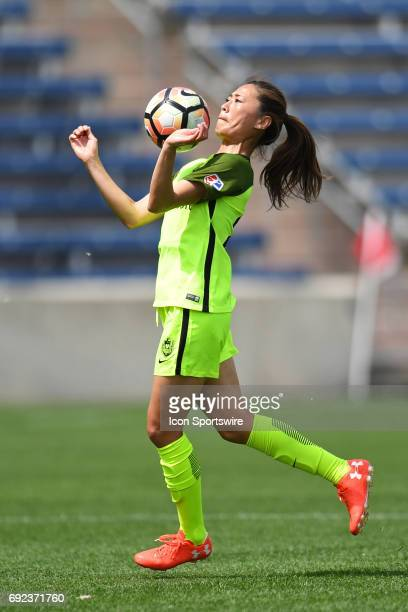 Seattle Reign FC midfielder Rumi Utsugi heads the ball in the first half during a game between the Seattle Reign and the Chicago Red Stars on June 4...