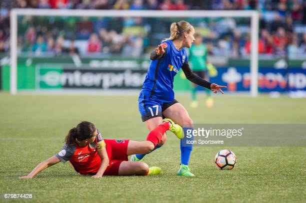 Seattle Reign forward Beverly Yanez is tackled by Portland Thorns forward Christine Sinclair during the 22 tie between Portland Thorns match and the...