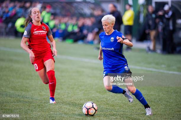 Seattle Reign forward Megan Rapinoe drives the ball in the wing during the first half of the Portland Thorns match against the Seattle Reign on May 6...