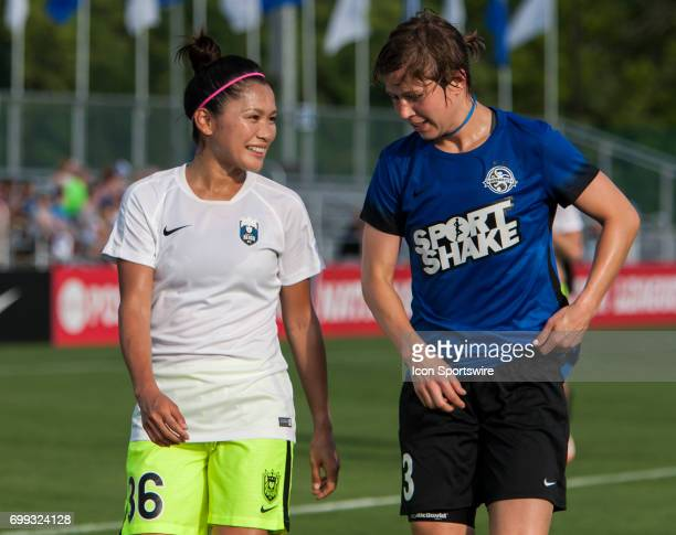 Seattle Reign Forward Nahomi Kawasumi and FC Kansas City Defender Becca Moros interact with each other while leaving the pitch before the NWSL match...