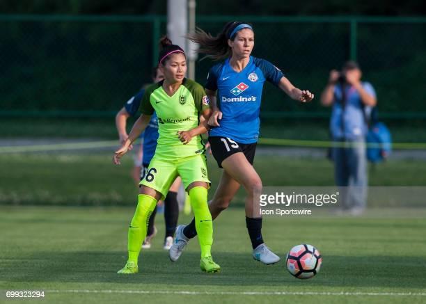 Seattle Reign Forward Nahomi Kawasumi attempts to move the ball past FC Kansas City Midfielder Erika Tymrak during the NWSL match between FC Kansas...