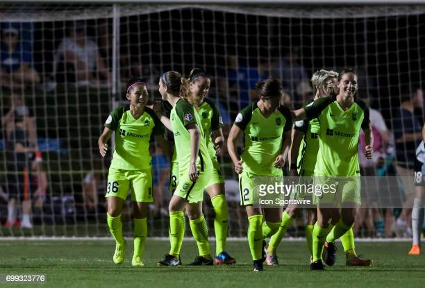 Seattle Reign Forward Nahomi Kawasumi celebrate with her teammates after scoring a goal during the NWSL match between FC Kansas City and the Seattle...