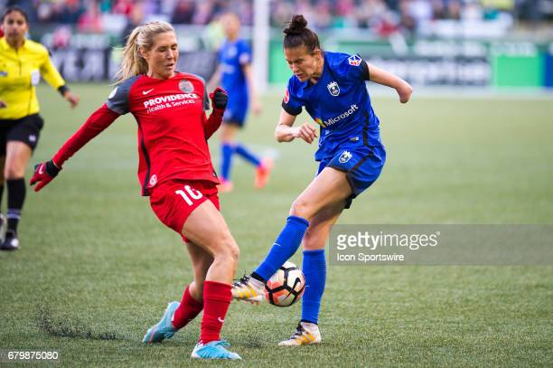 Seattle Reign midfielder Carson Pickett shot on goal is blocked by Portland Thorns midfielder Allie Long during the 22 tie between Portland Thorns...