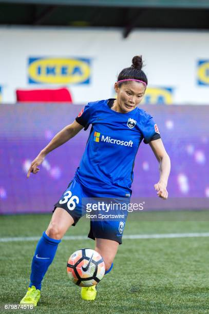 Seattle Reign midfielder Nahorri Kawasumi looks for a cross during the 22 tie between Portland Thorns match and the Seattle Reign on May 6 at...