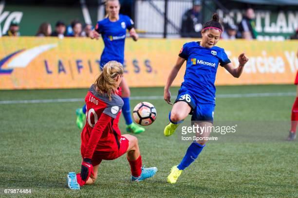 Seattle Reign midfielder Nahorri Kawasumi's cross is blocked by Portland Thorns midfielder Allie Long during the 22 tie between Portland Thorns match...
