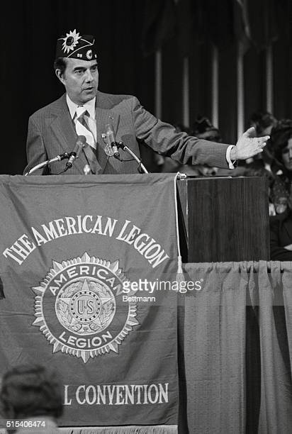 Republican vice presidential candidate nominee Se Robert Dole RKan holds his hand up to say that Pres Ford has already extended the hand of mercy to...