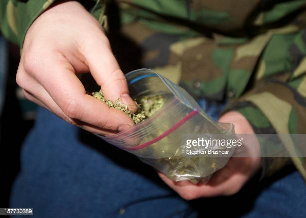 Seattle resident takes marijuana from a plastic bag shortly after a law legalizing the recreational use of marijuana took effect on December 6 2012...