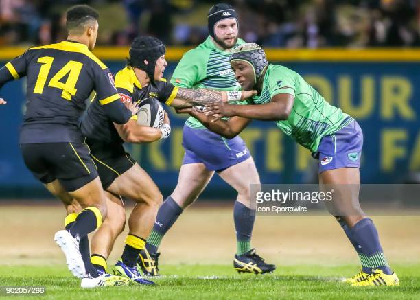 Seattle Saracens Driu Neori challenges Houston SaberCats flyhalf Chris Slater for ball during the opening rugby match between the Seattle Saracens...