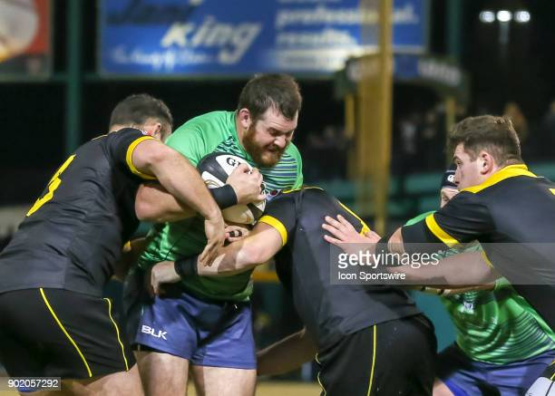 Seattle Saracens flyhallf Zach Burns gets tackled during the opening rugby match between the Seattle Saracens and Houston SaberCats on January 6 2018...