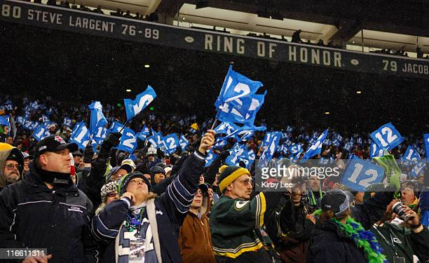 Seattle Seahawk fans wave 12th player flags in the snow during ESPN Monday Night Football gmae against the Green Bay Packers at Qwest Field in...