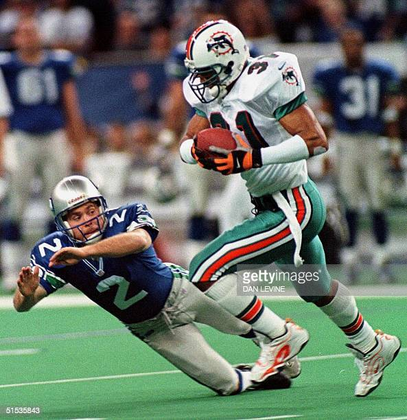 Seattle Seahawk kicker Todd Peterson dives to make the tackle on Miami Dolphin Brock Marion during his 47-yard first quarter kickoff return at the...