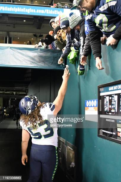 Seattle Seahawks center Joey Hunt hands a fan a souvenir during the Playoff game between the Seattle Seahawks and the Philadelphia Eagles on January...