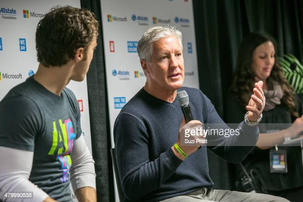 Seattle Seahawks Coach Pete Carroll and Craig Kielburger attend We Day at Key Arena on March 21, 2014 in Seattle, Washington.