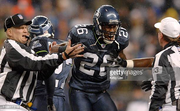 Seattle Seahawks cornerback Ken Hamlin is restrained by umpire Bill Schuster left while arguing with referee Bill Carollo during ESPN Monday Night...
