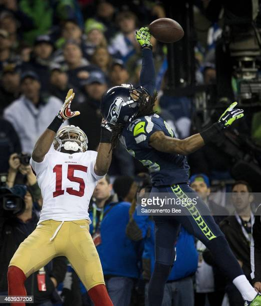 Seattle Seahawks cornerback Richard Sherman hits ball away from San Francisco 49ers wide receiver Michael Crabtree and is intercepted by Seattle...