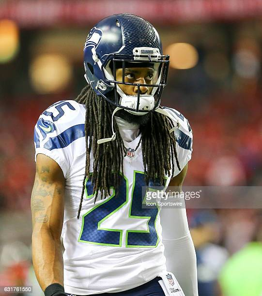 Seattle Seahawks cornerback Richard Sherman looks on during the NFC Divisional Playoff game between the Seattle Seahawks and the Atlanta Falcons on...