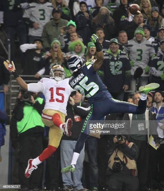 Seattle Seahawks cornerback Richard Sherman tips away a pass from San Francisco 49ers wide receiver Michael Crabtree in the end zone late in the NFC...