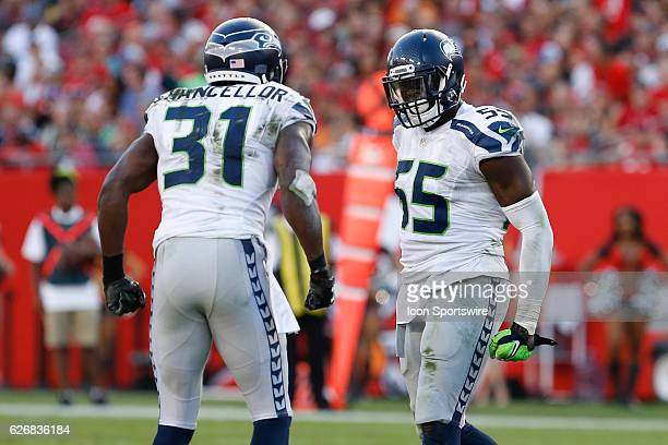 Seattle Seahawks defensive end Frank Clark celebrates with Seattle Seahawks strong safety Kam Chancellor after making a tackle during the NFL game...