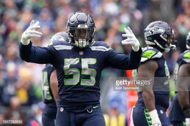 Seattle Seahawks defensive end Frank Clark gets the crowd pumped up in the second quarter during a game between the Los Angeles Rams and the Seattle...