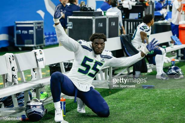Seattle Seahawks defensive end Frank Clark is seen on the sideline celebrating a defensive play during a regular season game between the Seattle...