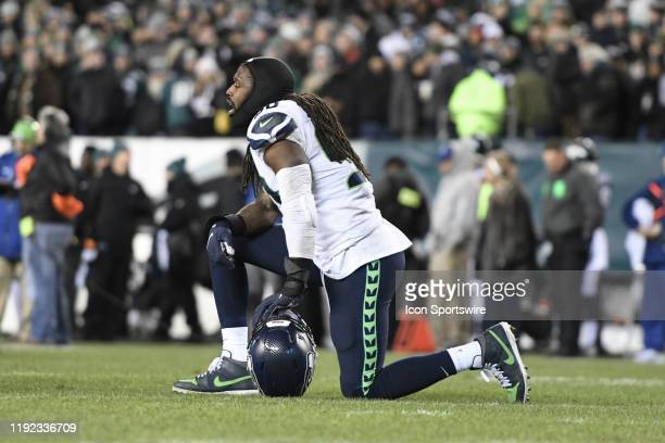Seattle Seahawks defensive end Jadeveon Clowney takes a knee during the Playoff game between the Seattle Seahawks and the Philadelphia Eagles on...