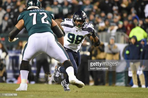 Seattle Seahawks defensive end Rasheem Green tries to beat Philadelphia Eagles offensive tackle Halapoulivaati Vaitai during the Playoff game between...