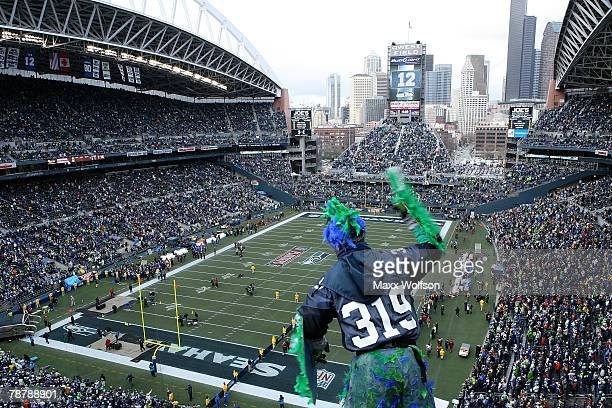 Seattle Seahawks fan cheers before the game between the Seahawks and the Washington Redskins before the NFC Wild Card game at Qwest Field on January...