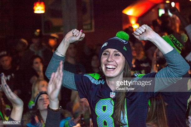 Seattle Seahawks fan Lynnsey Sturgeon reacts while watching her team play the Denver Broncos in the Super Bowl at 95 Slide a sports bar in Seattle...